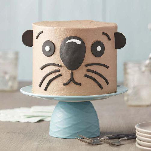 Adorable brown otter cake with black fondant features