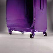 "American Tourister iLite Max 21"" Spinner in the color Purple."