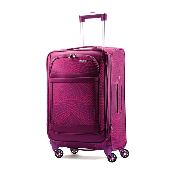 "American Tourister iLite Max 21"" Spinner in the color Pink/Purple Stripes."