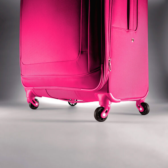 "American Tourister iLite Max 29"" Spinner in the color Raspberry."
