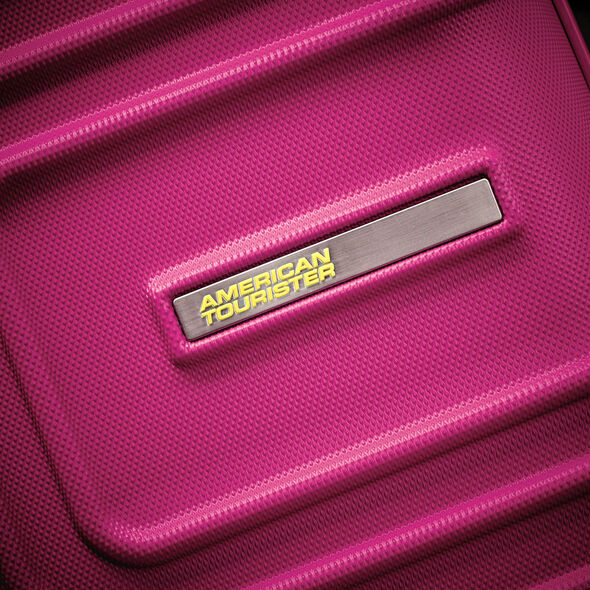 "American Tourister Sunset Cruise 20"" Spinner in the color Pink Berry."