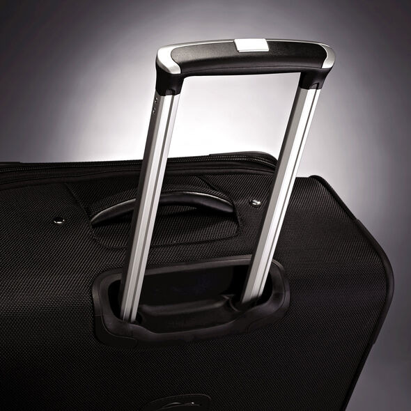 "American Tourister Triumph DLX 21"" Spinner in the color Black."