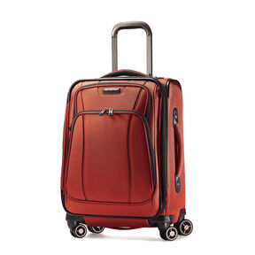 "Samsonite DK3 21"" Spinner in the color Orange Zest."