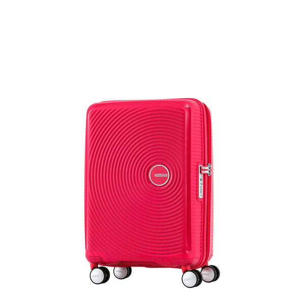 "American Tourister Curio 20"" Spinner in the color Pink."