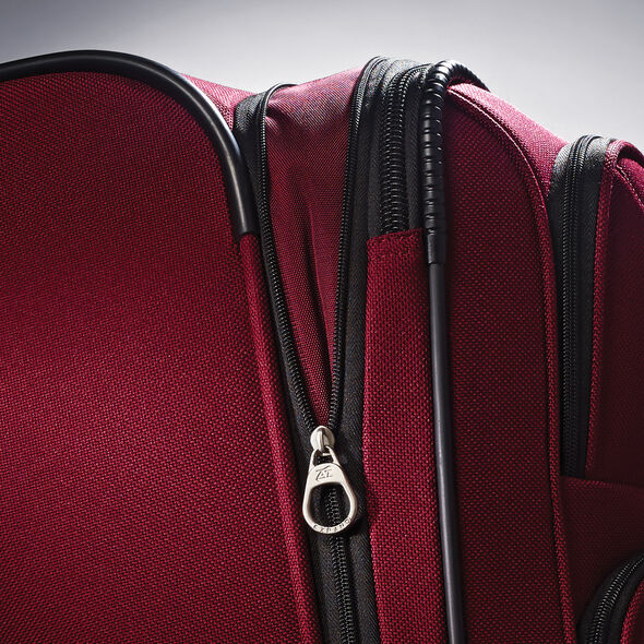 """American Tourister Bedford 21"""" Spinner in the color Ruby Red."""