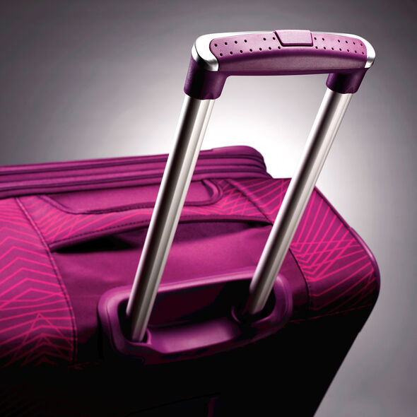 "American Tourister iLite Max 25"" Spinner in the color Pink/Purple Stripes."