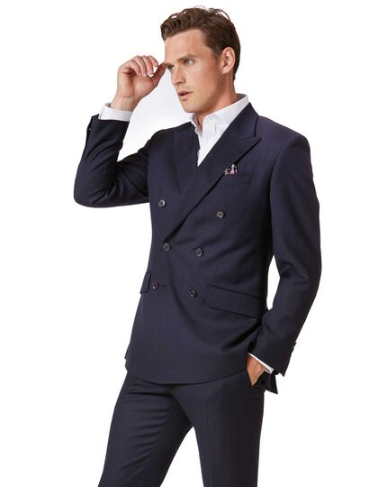 Modern cut double breasted grey suit. Slim cut jacket paired with slim fit flat front trouser. Jacket featured with peak lapel, six button in total (2 to close, 4 decorative), inside with 2 pockets and a pen pocket, outside 2 flapped pocket with ticket pocket and chest pocket.