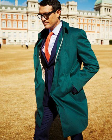 Slim fit green raincoat