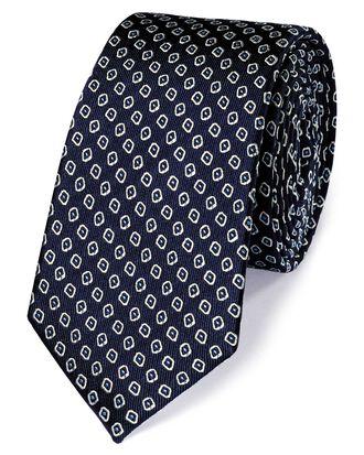 Cravate classique slim bleu marine et blanche en soie impeccable à motif losanges