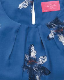 Women's semi-fitted royal blue painted flower print shell top
