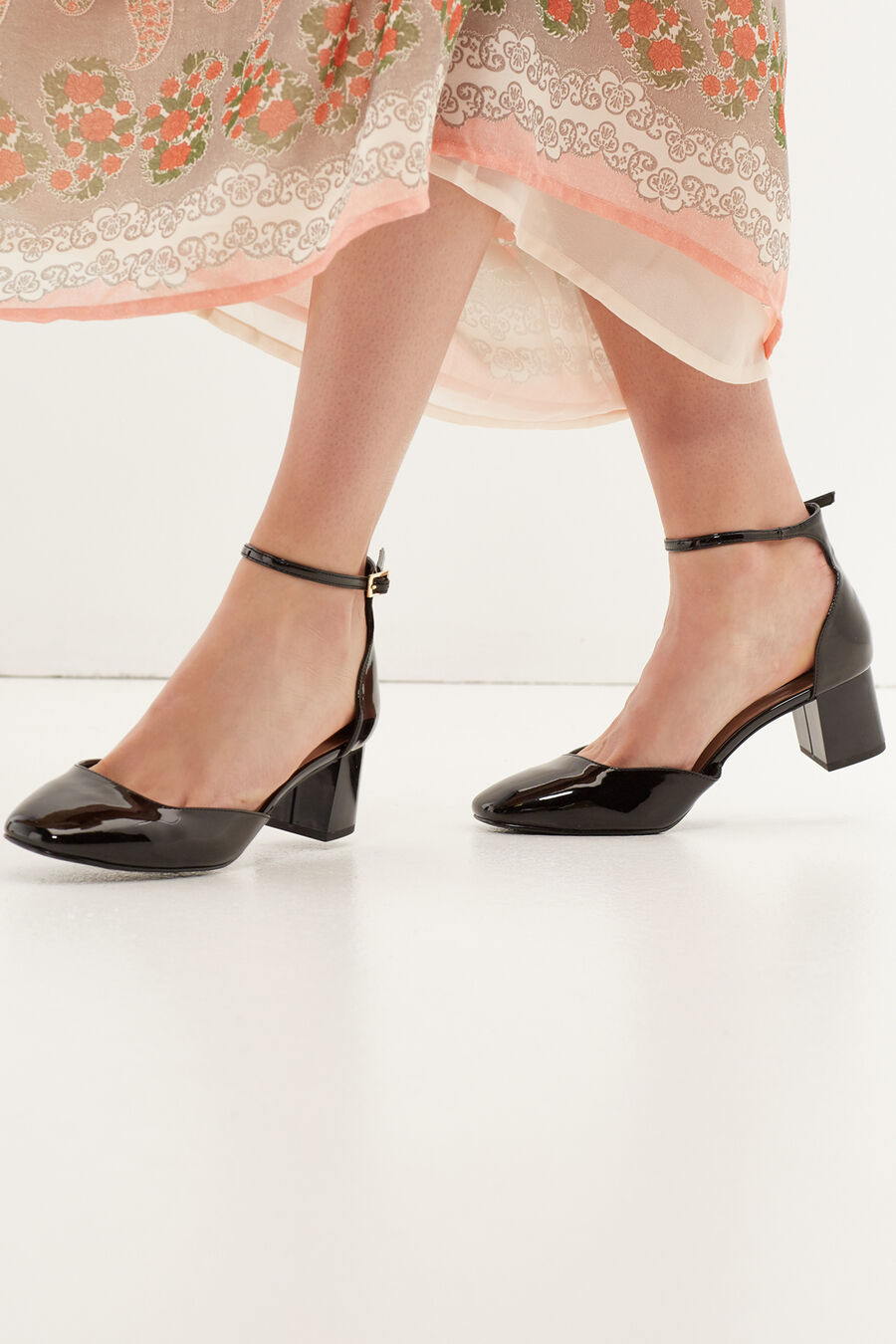 Patent leather wing tip heels
