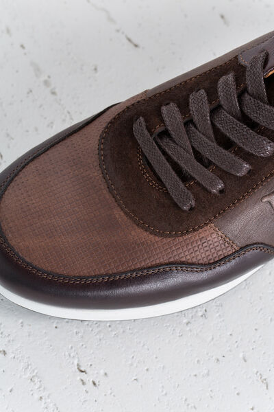 Sneaker icono tela piel