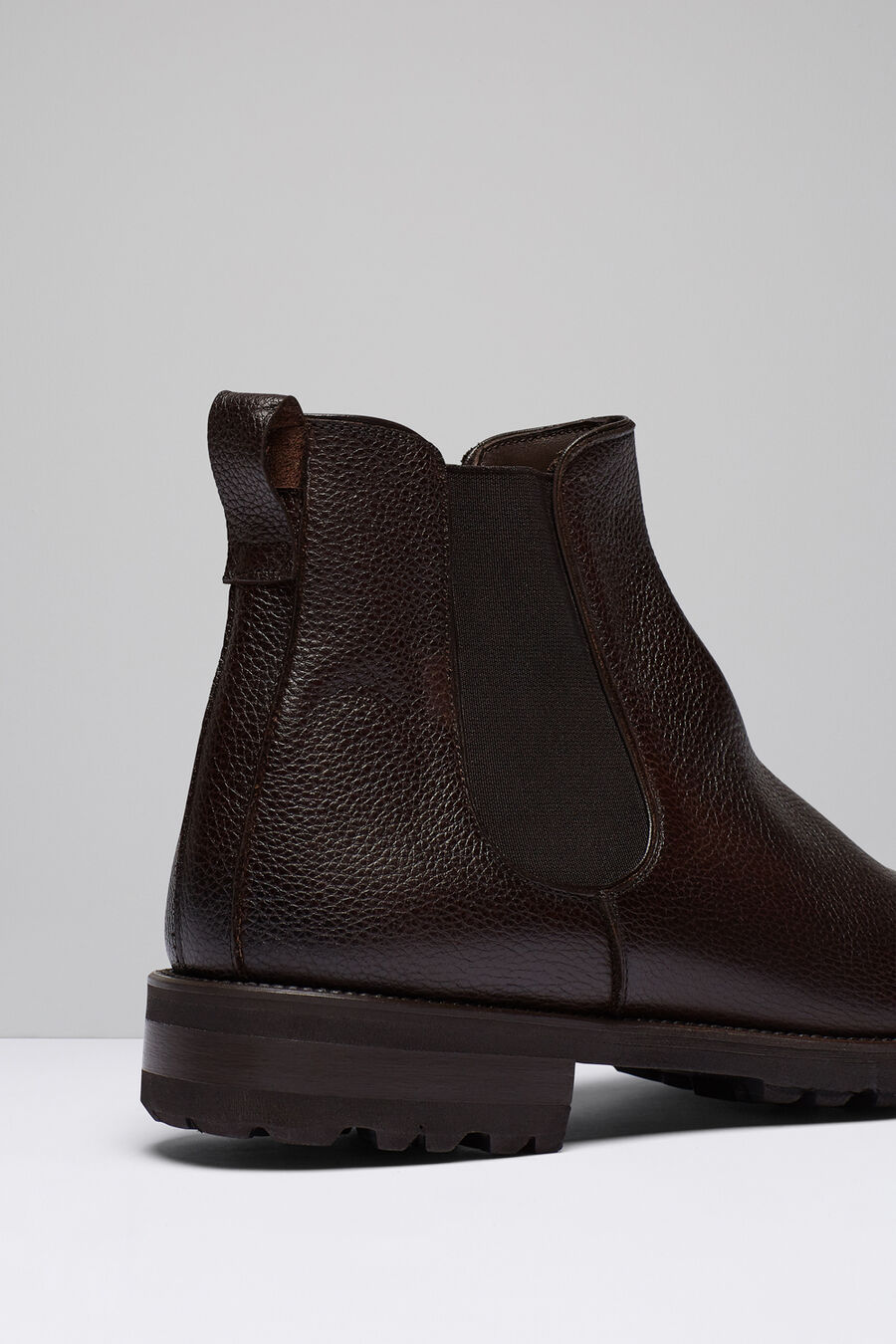 Chelsea boots with cleated soles