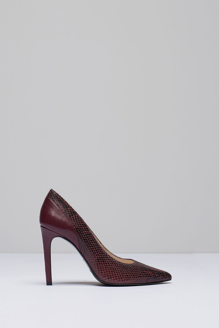 Snakeskin court shoes