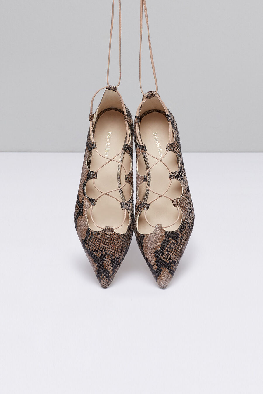 Lace up faux snakeskin shoes