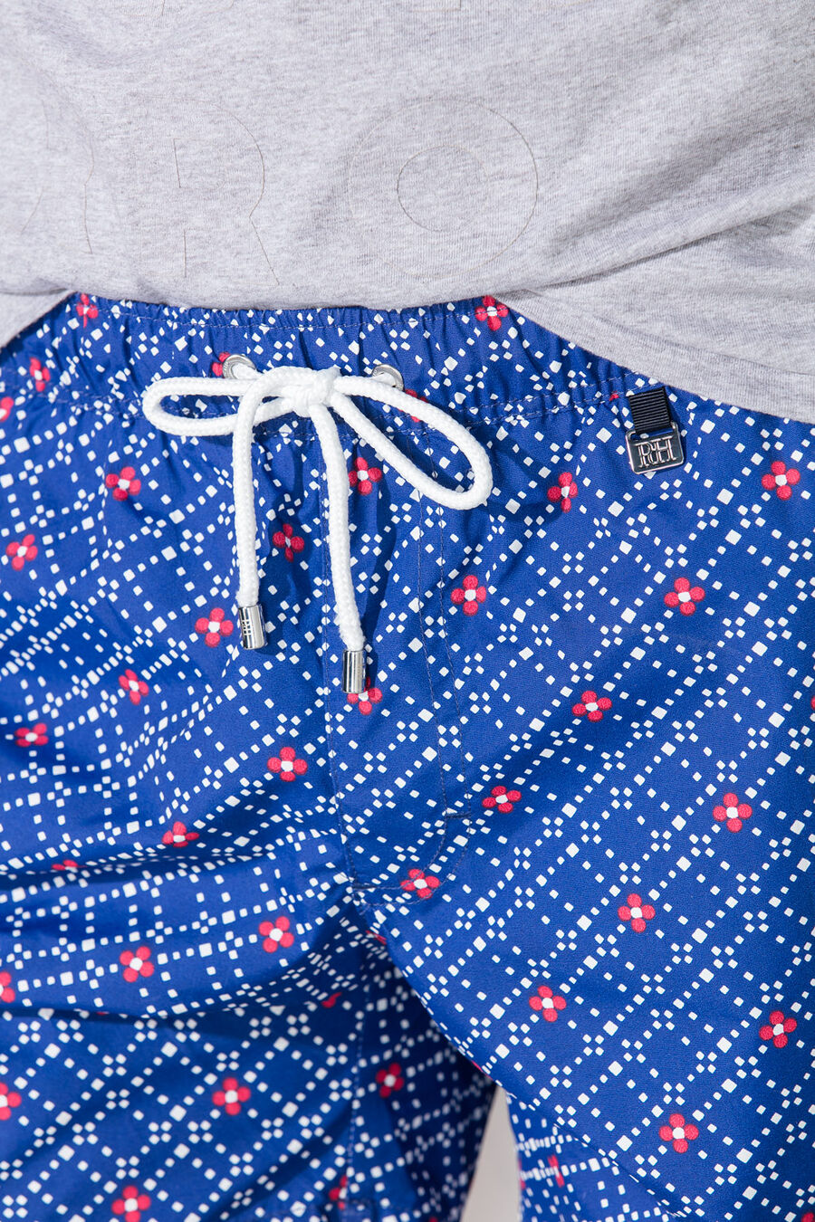 Geometric flower print swim shorts