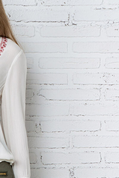 EMBROIDERED BLOUSE WITH POM-POMS