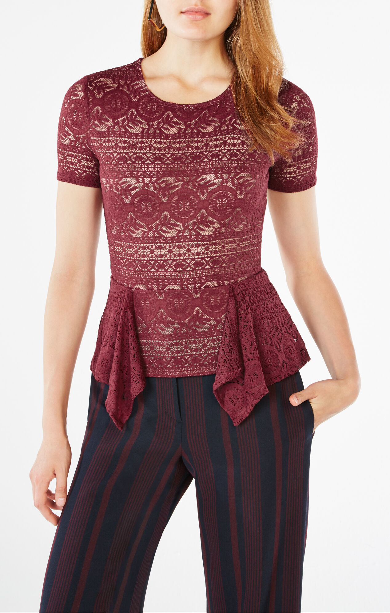 Show off your dramatic side in this deep V neck, lace peplum top with zip trim detailing.