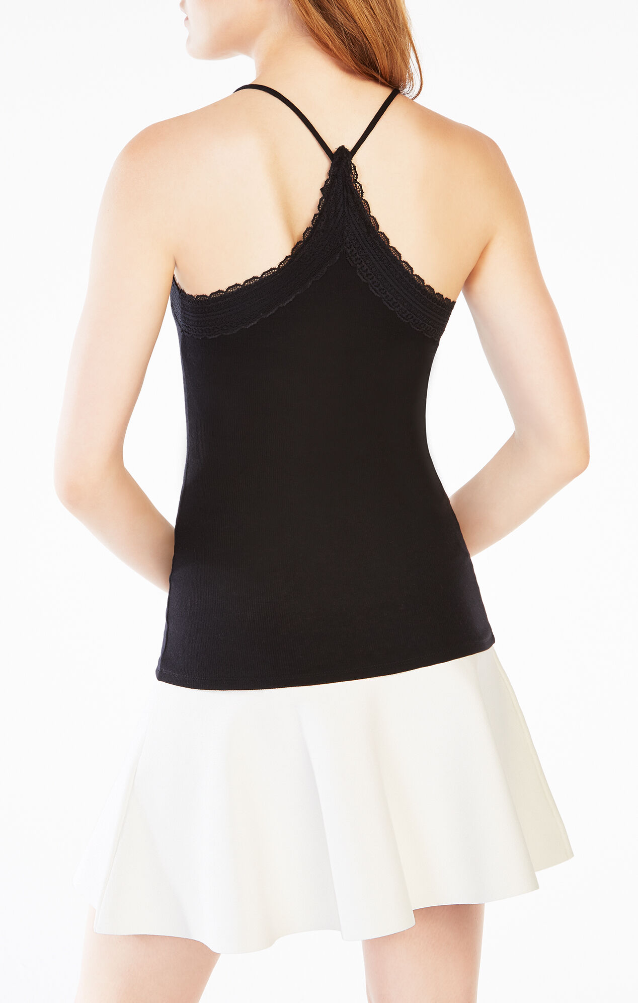 A comfy ribbed tank with a pretty lace trim that's perfect on its own or layered under your favorite blazers, sweaters, and low-cut dresses. Cotton/poly/spandex.