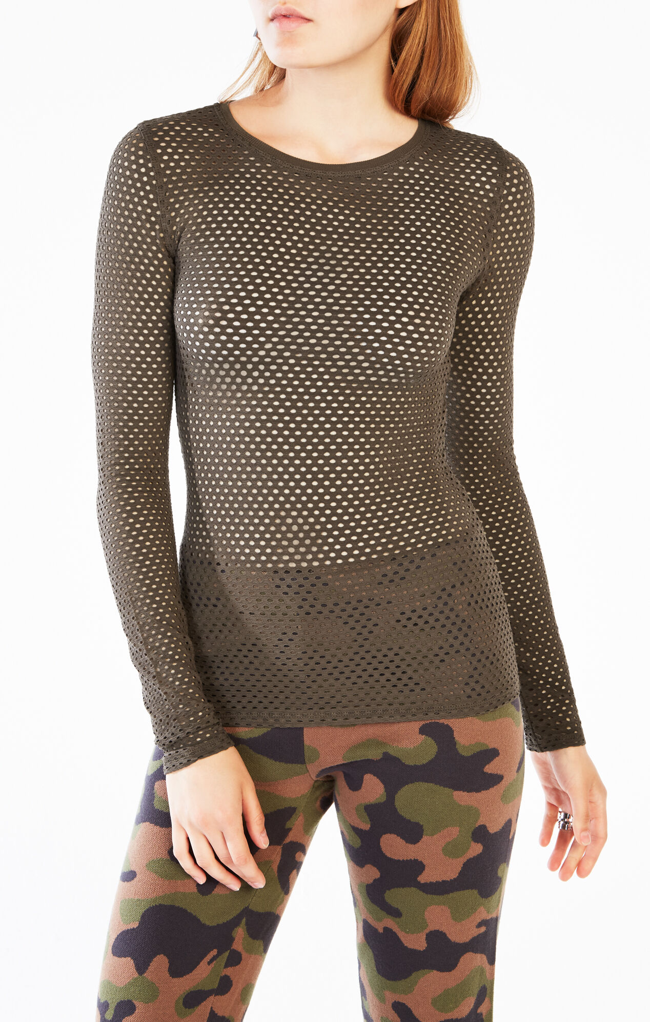 Lulus Exclusive! Give your basics and edgy twist with the Lulus Mesh Is More Black Mesh Long Sleeve Top! This basic jersey knit top, with a rounded neckline, long sleeves, and a relaxed bodice, gets a trendy upgrade from a panel of sheer mesh along the neckline.
