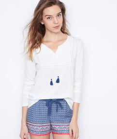 Blusa con detalle pompones blanco.