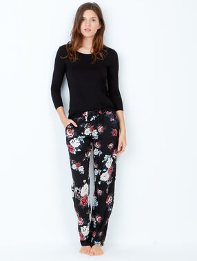 Pantalon imprimé fleuri noir.