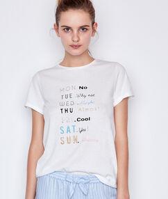 T-shirt à message blanc.