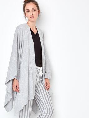 Poncho majoritairement coton gris.