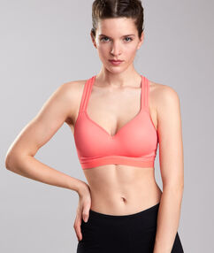 Brassière de sport maintien fort orange.