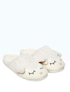 Mules mouton en tricot beige.
