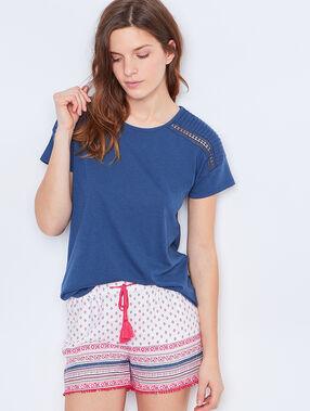 T-shirt épaules ajoure bleu.