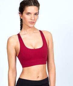 Brassière de sport, matière ultra-strech et ultra-respirante, dos nageur rouge.