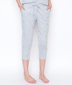 Pantalon imprimé palmiers dorés gris.