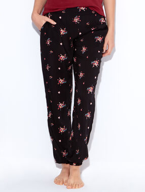 Pantalon imprimé fleurs noir.