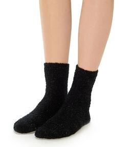 Chaussettes épaisses pailletées noir.