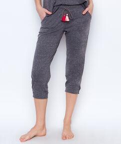 Pantalon pompoms gris.
