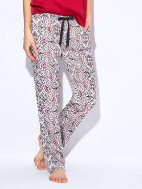 Pantalon imprimé graphique rouge / écru / noir.
