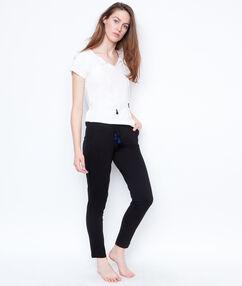 Spodnie z pomponami noir.