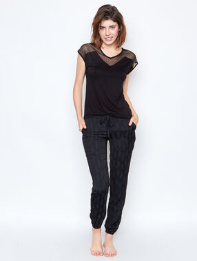 Pantalon motif feuille ton sur ton noir.