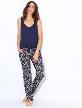 Pantalon imprimé fleuri bleu marine.
