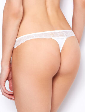 Lace and micro thong white.