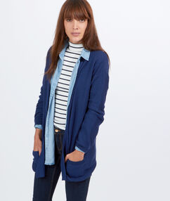 Gilet long à poches bleu.