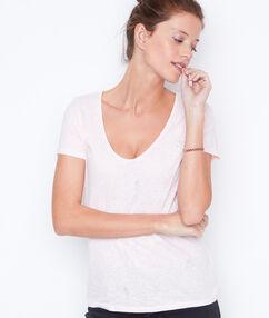 Camiseta manga corta estampada maquillaje.
