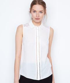 Chemise sans manches empiècement dentelle blanc.