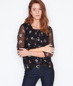 Blusa estampado floral y mangas transparentes negro.