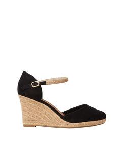 Sandales compensées en suédine noir.