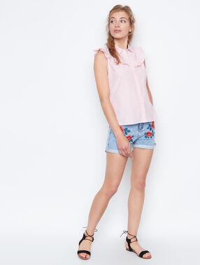Chemise rayée à volants corail.
