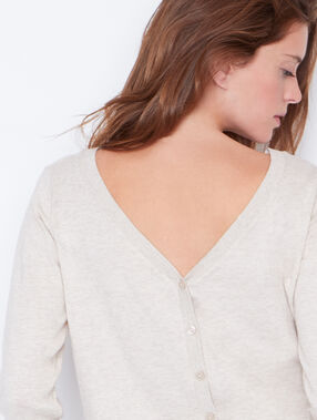 Button back round collar sweater light beige.