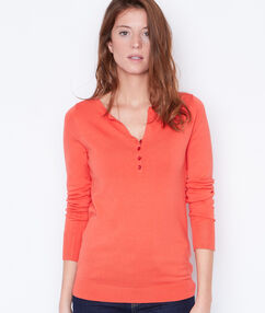 V-neck sweater with button coral.