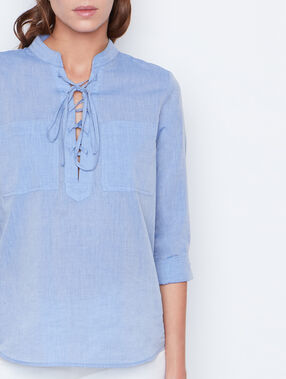 Chemise col tunisien bleu clair.